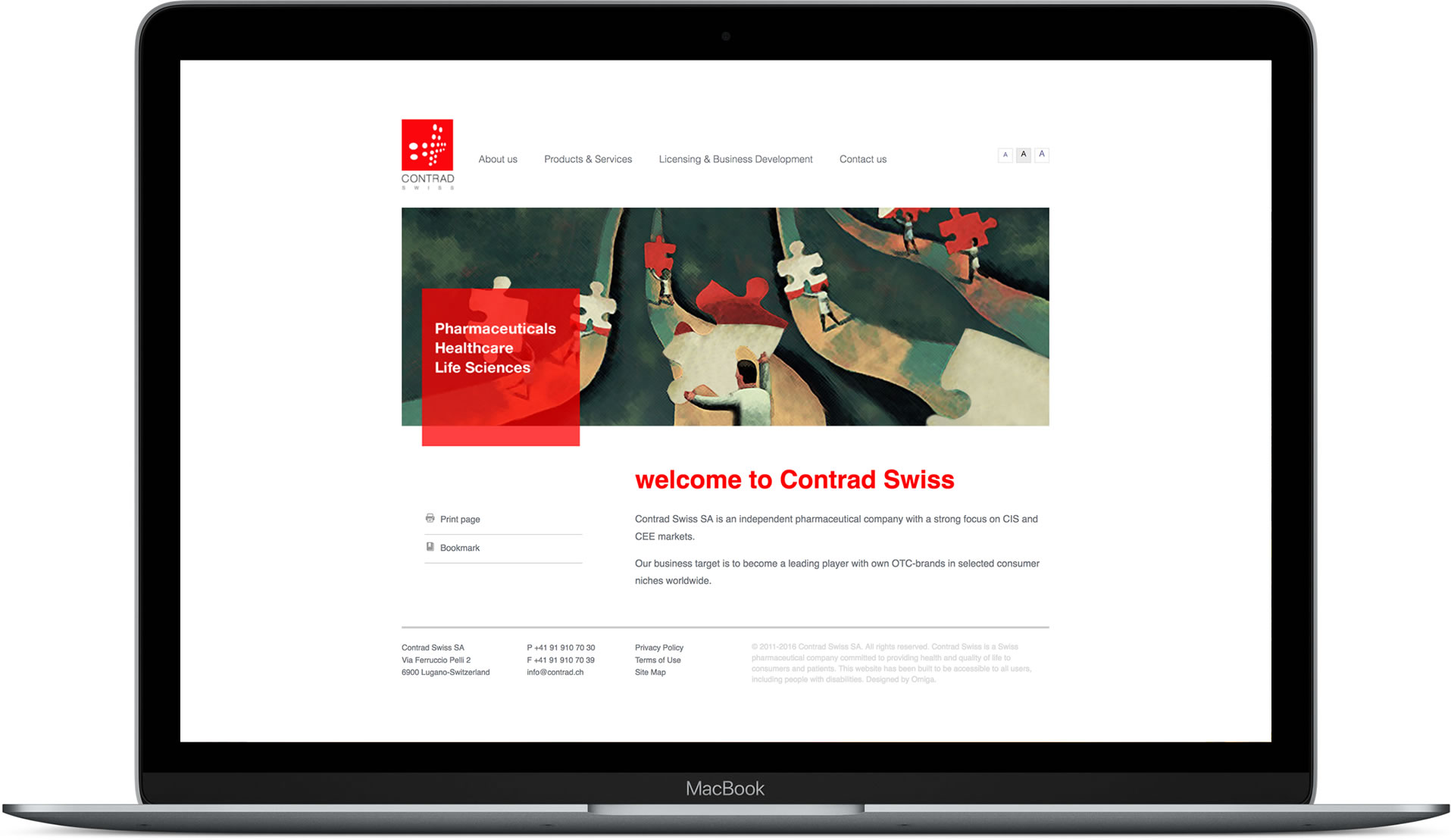 Website designed for Contrad mocked up in MacBook